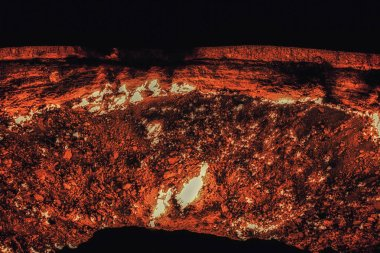 Derweze or Darvaza, aka the Door to Hell is a huge crater of burning natural gas in the Kara-kum desert in Turkmenistan.