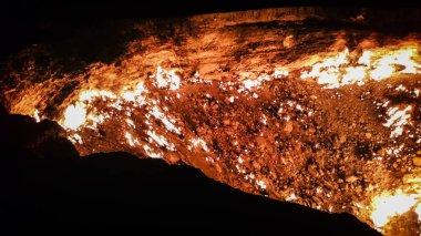 Turkmenistan gates of hell gas crater fire in Karakum desert near Darvaza. Burning methane gas crater in Derweze in Karakum desert. Door to hell in Turkmenistan.