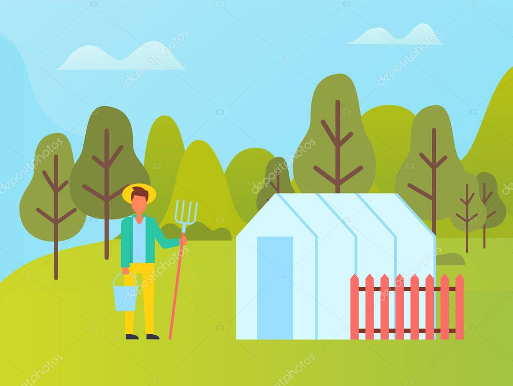 Farmer with Fork near Greenhouse with Red Fence