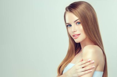 Beautiful young woman with clean fresh skin,. Close up portrait. Cosmetic, cosmetology and skin care