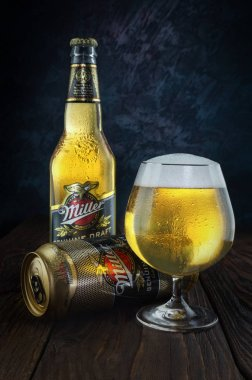 Miller beer in bottle, can and glass