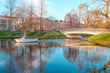 Bridge in park over canal water, Leiden, Netherlands.