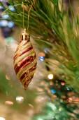 Ornate bauble hanging on festive Christmas fir tree