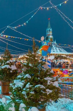 New Year trees and festival attractions on street in Moscow, Russia