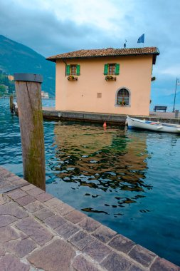Traditional rowing boat moored at house in Riva del Garda, Trento, Italy, Europe