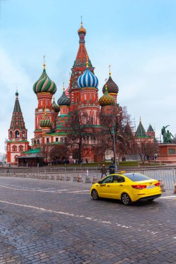 Moscow, Russia - Dec 29, 2019: New year in the Russian capital. Christmas in Moscow. Red square. Moscow Kremlin. Yellow taxi.
