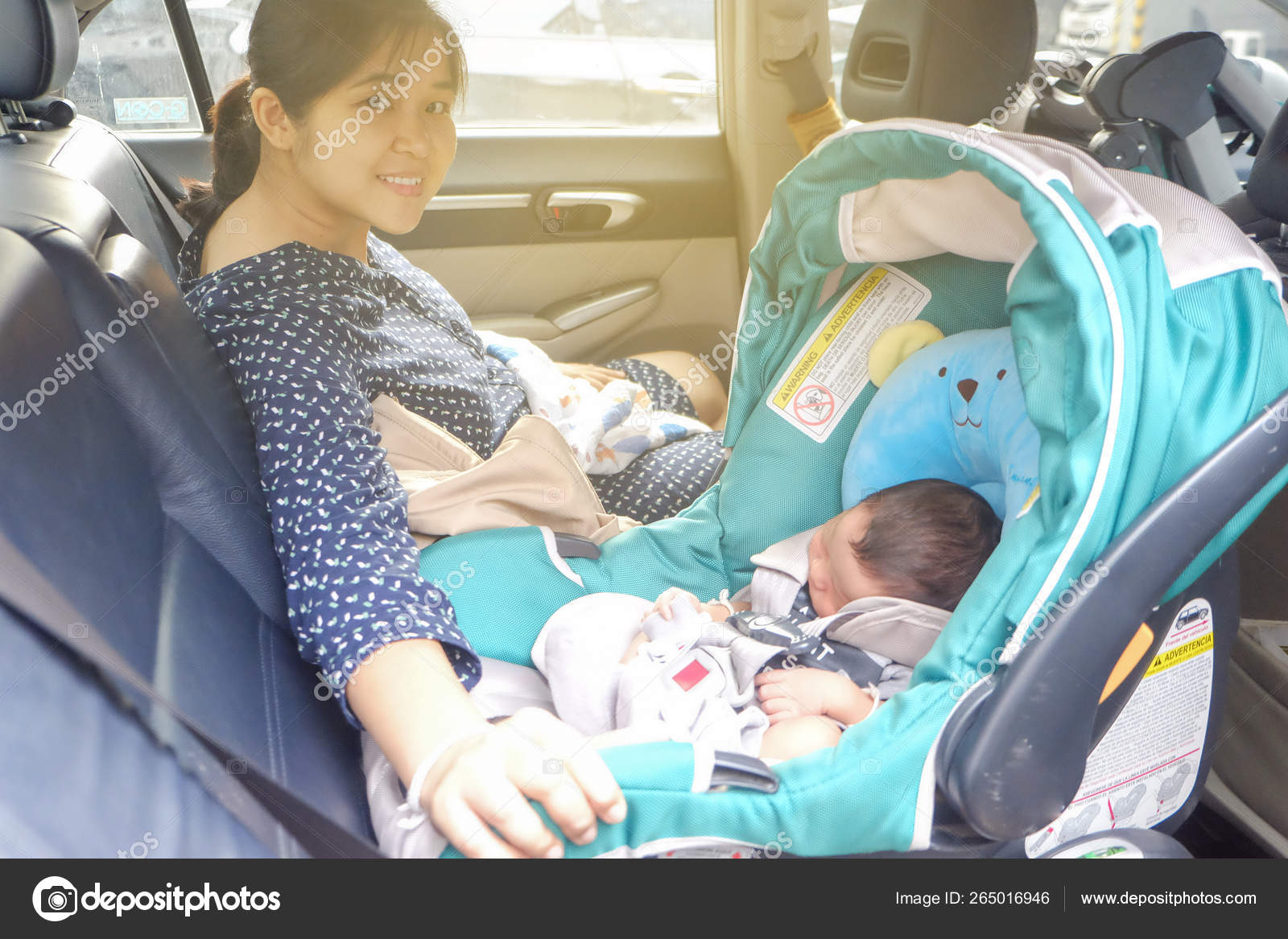 Picture of: Mom With Infant Child Boy Inside Savfty Car Seat Stock Photo C Benedixs 265016946