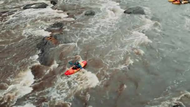 Rafting on a mountain river, aerial view. Rafting on a mountain river on a sunny spring day.