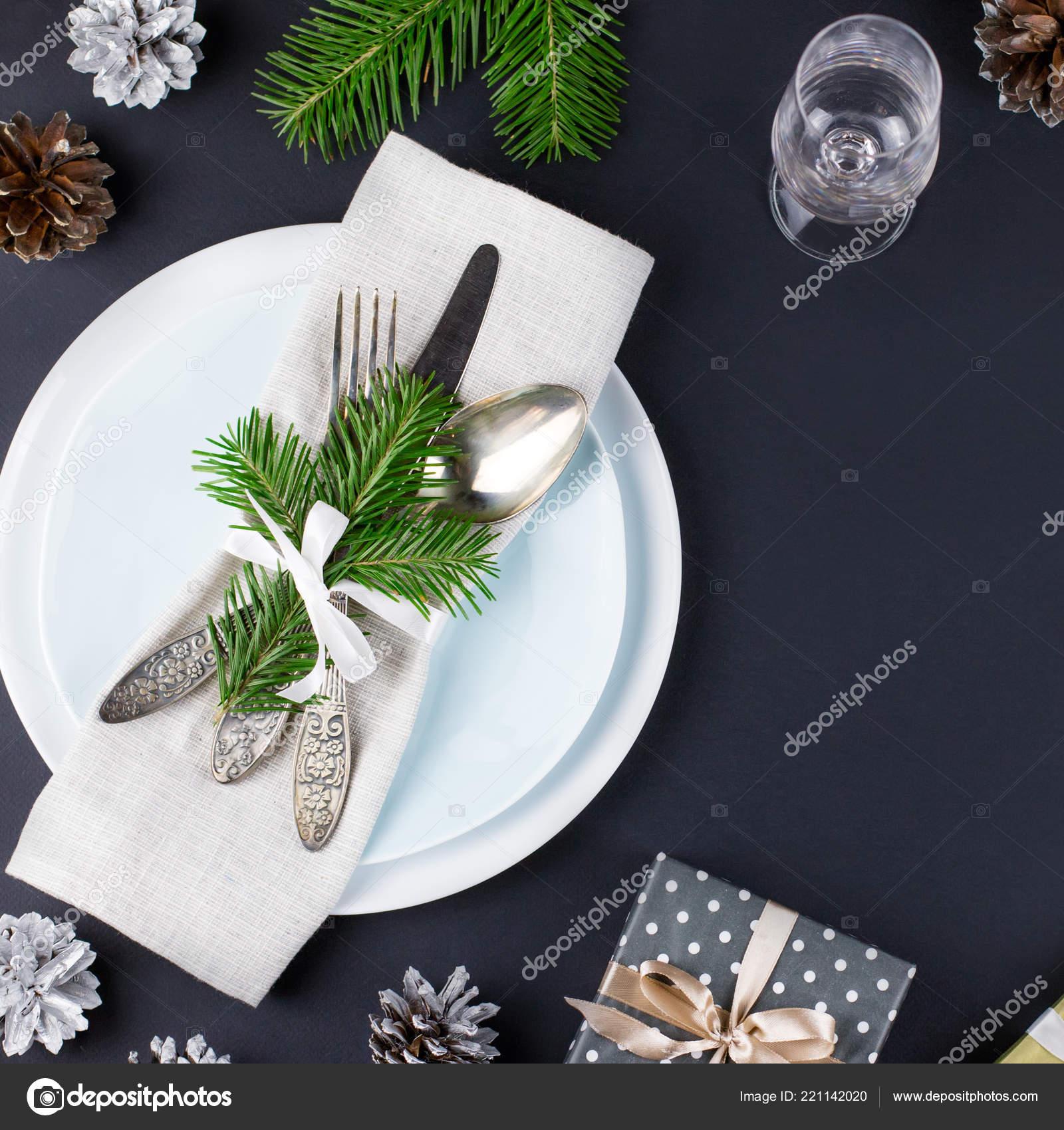 Christmas Table Setting Plates Silverware Gift Box Decorations Black Gold– stock image