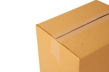 A carton on a white background is covered with an adhesive tape. Isolated