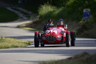 PESARO COLLE SAN BARTOLO , ITALY - MAY 17 - 2018 : GILCO MARIAN FIAT 1100 SPORT1948  on an old racing car in rally Mille Miglia 2018 the famous italian historical race (1927-1957)