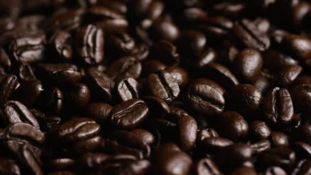 Rotating shot of delicious, roasted coffee beans on a white surface