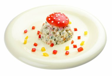 Russian salad with a fun design. On white background. Meals for children.