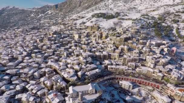 Slow motion drone shot flying backwards in Arachova - Greece