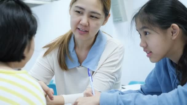 4K Happy Asian student girls studying with teacher in classroom