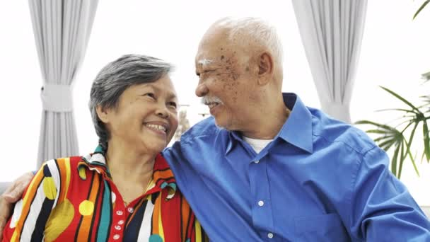 Portrait of asian senior couple looking a camera with smile face, UHD Slow motion ,Dolly shot.