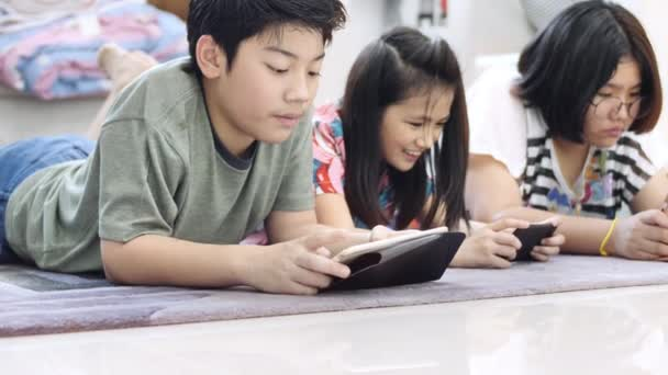Child Playing Tablet Smartphone Home Asian Boy Girl Playing Game ⬇ Video by  © sirikornt Stock Footage #257148414