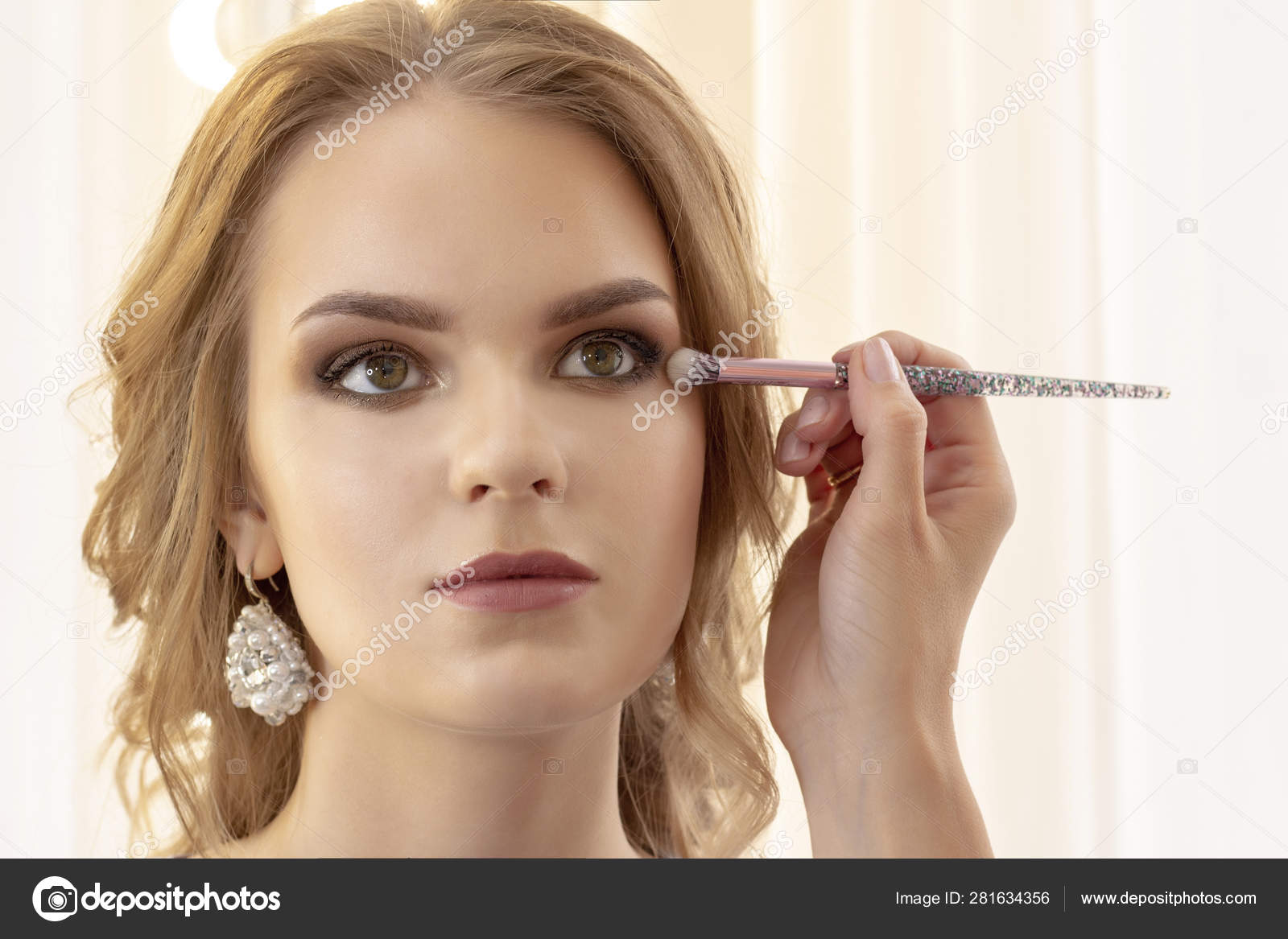 Makeup Artist Puts Makeup Girl Model Brush Applies Shadows