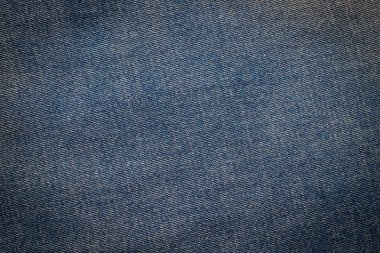 Macro, Close-up of texture details of denim blue jeans. Pattern of fabric or textile is abstract background. Concept design  fashion and retro stlye.
