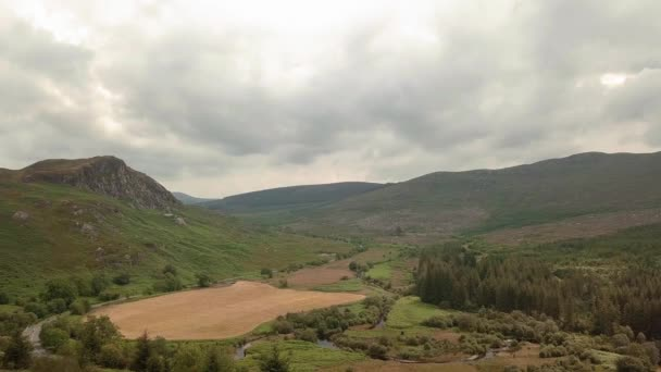 Aerial view of forests, mountains and river in green scottish landscapes, highlands