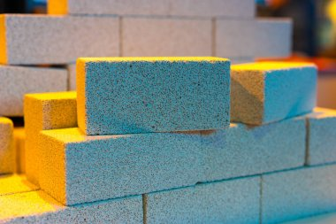 Foam concrete. Construction of houses from foam concrete. The wall is lined with white bricks. Building. Building concept.
