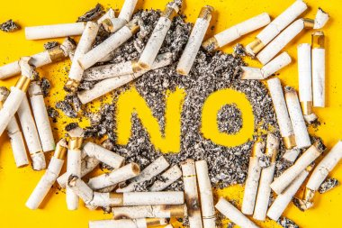 Quit smoking. Bad habit of smoking. The word is not from the ashes. Cigarette stubs with ashes. Cigarette stubs.
