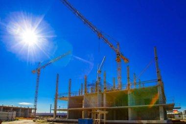 Construction site. The sun illuminates the construction of the building. Multi-storey building. stock vector