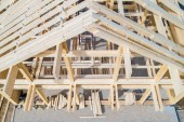 Fotografie The wooden skeleton of the house top view. Construction site. Wo