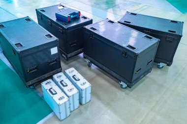 Boxes on wheels. Transportation of boxes and suitcases with equi