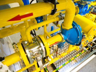 Yellow gas pipes. Gas transportation hub. Stationary compressor station. Gasification business. Centralized gas supply to the city. Compressor station at the factory.Pipeline transportation of methane