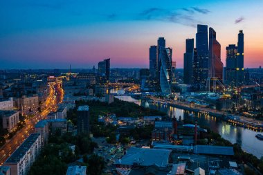 View of evening Moscow from a bird's eye view. Evening in the capital of Russia. river Moscow. Moscow-city. Skyscrapers against the evening sky. Tall building. Urban architecture. Urban landscape.