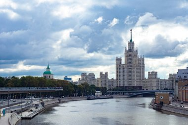 View of Moscow on a cloudy day. River Moscow.High-rise building on Kotelnicheskaya embankment. Park Zaryadye. Pedestrian platform over the river. Business card of Moscow. View of the capital of Russia