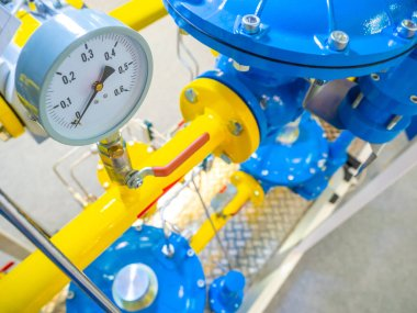 Gas networks. Yellow pipes with gas. Compressor station. Gas pumping station. Tetannaya in production. Compressor station with yellow pipes. Lack of pressure in the pipes. Pressure indicator at zero