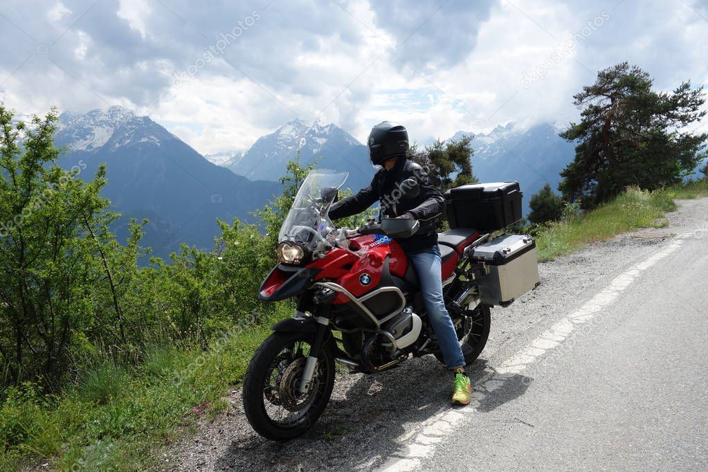 biker in Aosta Valley, Alps Mountains, Italy