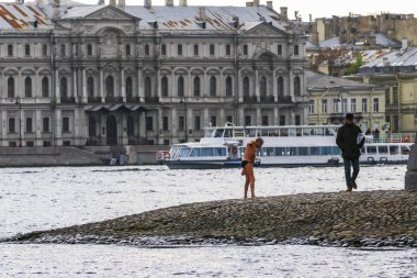 St Petersburg, Russia A senior man prepares to swim in te Neva River from the Peter and Paul Fortress island.