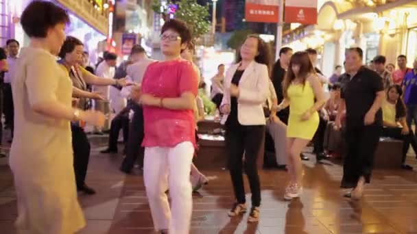 SHANGHAI,China- Sep 06: A group of women dancing in the middle of modern, shopping Nanjing street in Shanghai