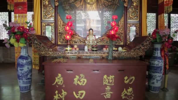 XIAN, CHINA - MAY 24, 2012: Visitors burn incense and pray in Daxingshan Temple