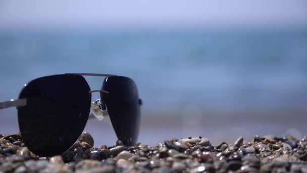 beach sunglasses vawessunglasses on the beach against the sea summer day