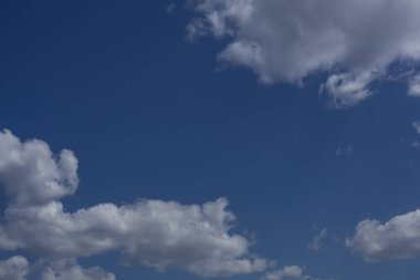White clouds with a beautiful blue sky in the background.