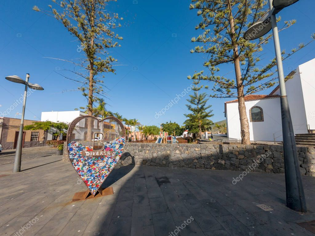 Buenavista, Spain - February 6: Heart shaped recycle bin for plastic on traditional spanish plaza, on February 6 2019 in Buenavista, Spain