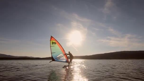 Windsurfing on the lake. Calm water. Slow wind. Vlasina Lake, Serbia