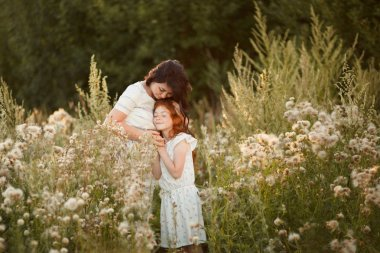 Love mom and daughter. family, child and parenthood concept