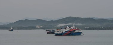 Phuket, Thailand - May 2, 2018. Passenger ferry on the sea in Phuket, Thailand. Phuket is Thailand largest island, and another 32 smaller islands off its coast.