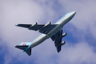 Jeju, South Korea - Sep 20, 2016. A Boeing 747-400 airplane of Korean Air taking-off from Jeju Airport (CJU) in sunny day.