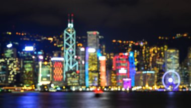 Blurred of finance buildings with many bokeh lights at night in Victoria Harbour, Hong Kong. stock vector