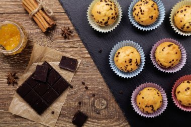 muffins with chocolate on a stone tray