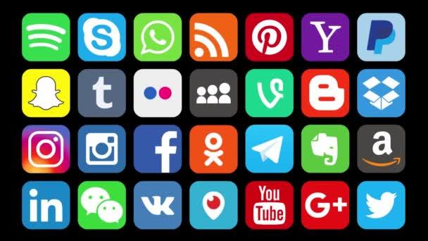 Kazan, Rusko-3. února 2018: animace populárních společenských médií: Instagram, Facebook, Twitter, YouTube, WhatsApp, LinkedIn, Pinterest, blogger a další, na černém pozadí.