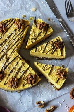 Raw vegan pumpkin cheesecake with walnuts and dark chocolate