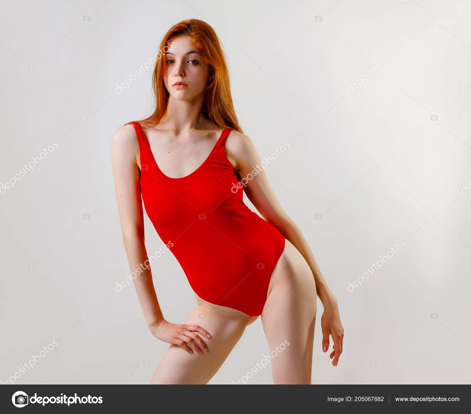 d4d9fdef66e Young Sexy Slim Woman Red Swimsuit Posing Studio Full Length — Stock Photo