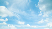 Blue sky with white clouds in daylight. /background/ copy space